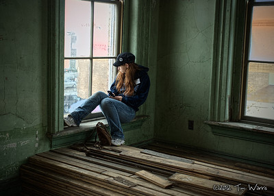 This is one of my favorite shots.  The soft lighting, the pensive girl and the great textures of the old building combine for what I think is one of my best images.  Oddly, this image sat on my hard drive for four years before I discovered it.  Taken in 2008 at the Canada Southern Train Station in St. Thomas, Ontario just before the station was completely restored.